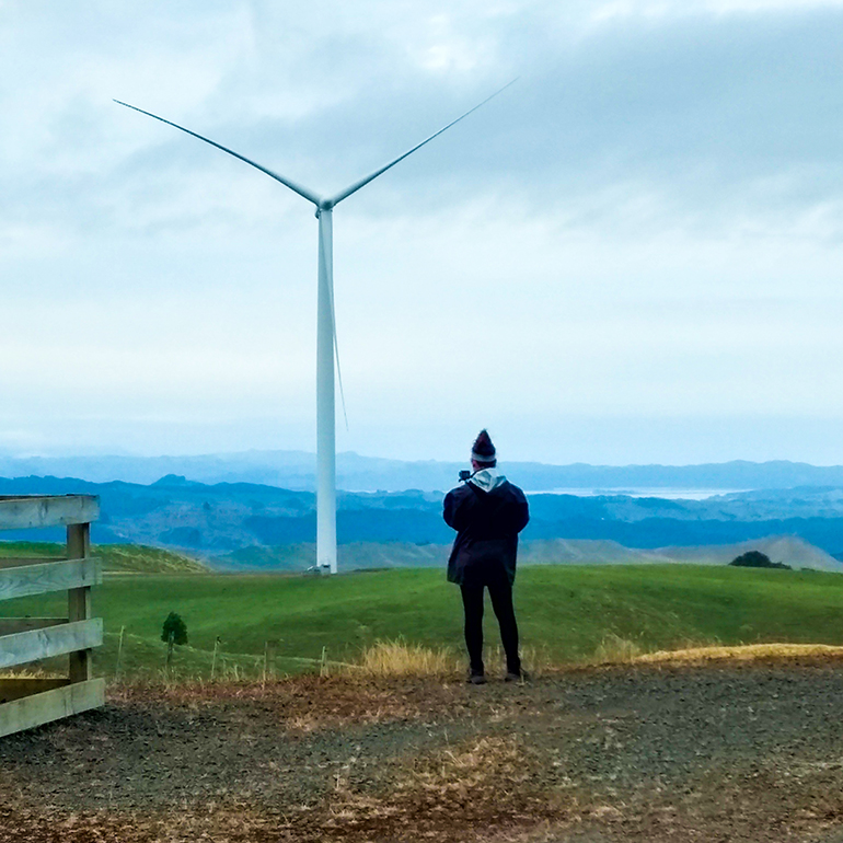 Student by Wind Turbine